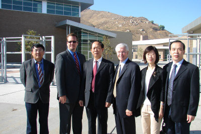 Dr. Li Chen and David Long at Hillcrest High School (source)