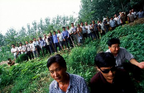 A photograph of Chen Guangcheng and villagers, by Du Bin, for the New York Times.