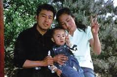 Xia Junfeng, wife, and son.