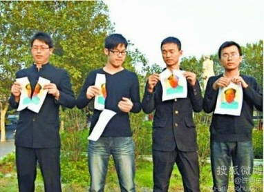 Tearing up Mao's photo in Zhengzhou, 2013. Far left is lawyer Ji Laisong. Click to enlarge.