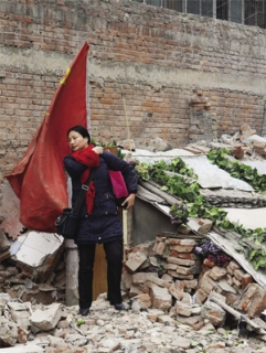 Jia Lingmin in front of her demolished home.