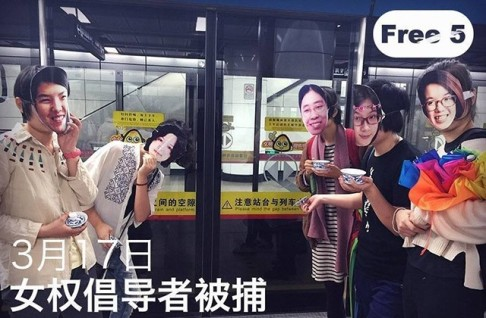 "Masked activists pose on a subway with tea cups. Being ""invited to drink tea"" is a common euphemism Chinese authorities use for bringing activists in for interrogation. Credit: China File."