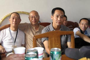 Chen Shuqing (front) and his friends from the China Democracy Party in 2010 when he was released from prison.