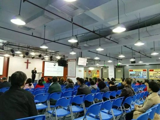 A recent photograph of church service at Living Stone, with Pastor Yang Hua preaching. The number of attendants at service has decreased significantly of late.